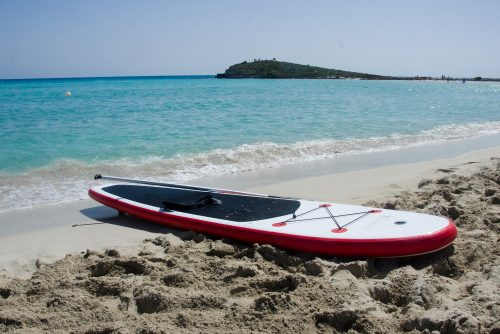 Sup Board On Nissi Beach On Sand By The Sea, Agia Napa, Cyprus, Mediterranean Sea. Copyplace, Place For Text
